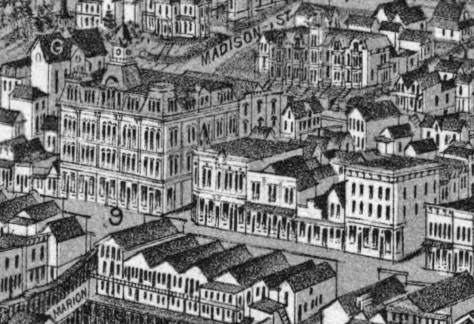 """A detail selected from the 1884 Birdseye of Seattle to look down at the intersections of Front Street (First Ave.) and Marion (left w. """"9"""" written on it) and Colubmia, right.  In 1884 the northwest corner of Marion and Front was grandly improved with the Frye Opera House, which kitty-korner the future site for the Colman Building was a long line of commercial sheds given a sometimes unifying front facade.  From the bottom of this detail to two block east at Second Avenue, the 1889 fire consumed it all."""