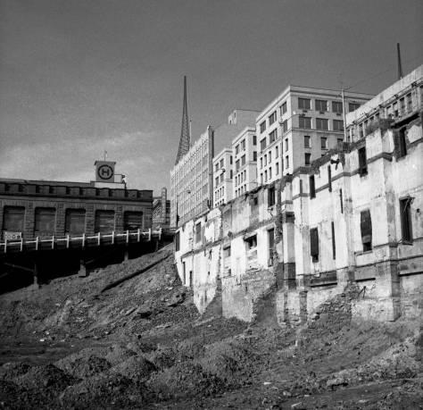 Frank Shaw's record of the Bay Building ruins, not from fire by the Harbor Steps developers urge to eventually construct the so-named development that has taken its place.  The last of the top portion of the University Street viaduct is seen on the left.  Shaw took this on March 11, 1975.