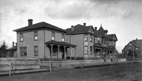 THEN: At the northwest corner of Columbia Street and Boren Avenue, two of the more ordinary housing stock on First Hill in the 1890s. (Courtesy MOHAI)