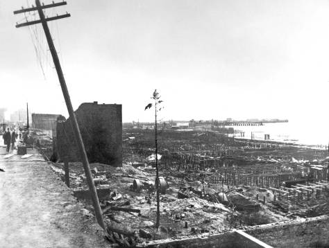 THEN: The ruins left by Seattle's Great Fire of June 6, 1889, included a large neighborhood of warehouses and factories built on timber quays over the tides. Following the fire the quays were soon restored with new capping and planking. A close look on the far-right will reveal some of this construction on the quays underway. (Courtesy, Seattle Public Library)