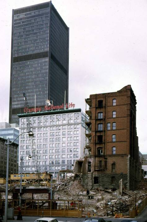 The SeaFirst tower seen over the wrecked of the Stevens Hotel, in the forground, and the Burke Building, still half-standing on the right, for the construction of the Federal Office Bldg (Named for Henry Jackson) in the 1970s. The Empire Building