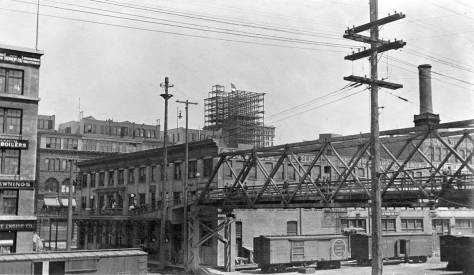 Above and below: The Marion Street viaduct over Railroad Avenue (Alaskan Way) then and now - nearly now.