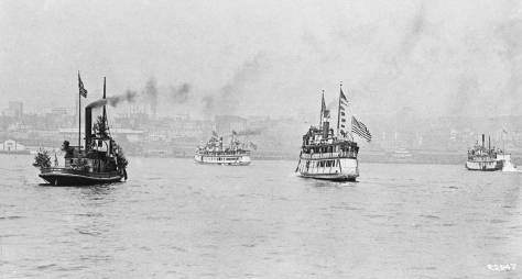 Part of the armada of steamers for the 1911 Potlatch - looking back from the Bay to Railroad Avenue.