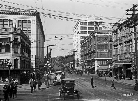 The terra-cotta replacement for our featured row house rises here ten stories above the southwest corner of 6th and Pine. Westlake crosses the bottom of the subject or scene. Frederick Nelson at its first five-story height is on the left. (Courtesy, Museum of History and Industry.)