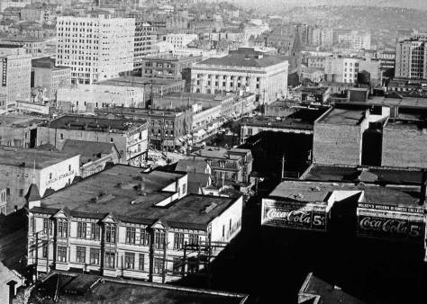 The Plummer Building, lower-right, at its last corner, the southwest one at Pine and 3rd Avenue. It was moved from the southeast corner of 3rd and Union to make room for the Federal Post Office, which appears here two blocks south on Third at its, again, corner with Union Street.