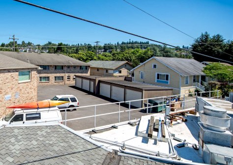 NOW: With no bucket truck or bathhouse roof to help him, Jean climbed a ladder and extended his ten-foot pole to get this repeat over the roof of the now 80-year-old Spud fish and chips on Alki Avenue.