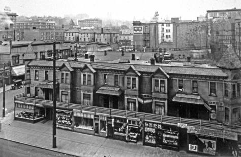 Looking down from the Frederick and Nelson roof (or upper floor) to the clapboard row at the southwest corner of 6th Avenue and Pine Street. (Courtesy, Museum of History and Industry)