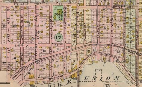 This detail from the 1908 Baist Real Estate Map show t he route of the trolley as it comes north off the Latona Bridge, bottom-center, and curves to the east eventually (and off-the detail) curving north to cross the railroad tracks at grade and reaching 14th Avenue NE, aka University Way which the neighborhood their was soon still called either Brooklyn or University Station. The map does not show, as yet, the underpass on NE 6th, the trolley's thereafter new route to the campus.