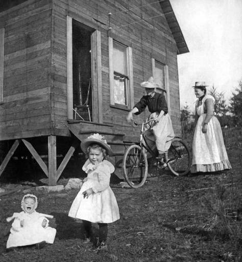 THEN: Midwife Alice Wood Ellis, far right, joins her mother and two children on the front lawn of their half-finished home in the East Green Lake neighborhood, ca. 1901. Courtesy Carol Solle