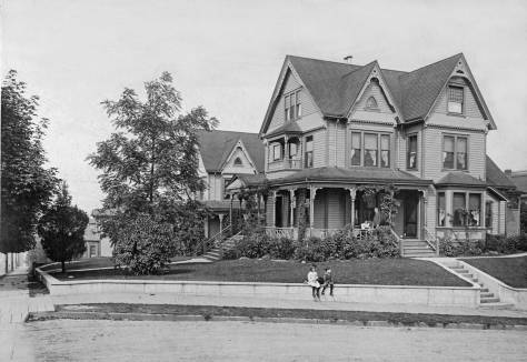 THEN: The northeast corner of Belltown's intersection of Blanchard Street and Fourth Avenue was about 100 feet higher than it is now. The elegant late-Victorian clutters of the Burwell homes' interiors are also featured on the noted blog. (Courtesy John Goff)