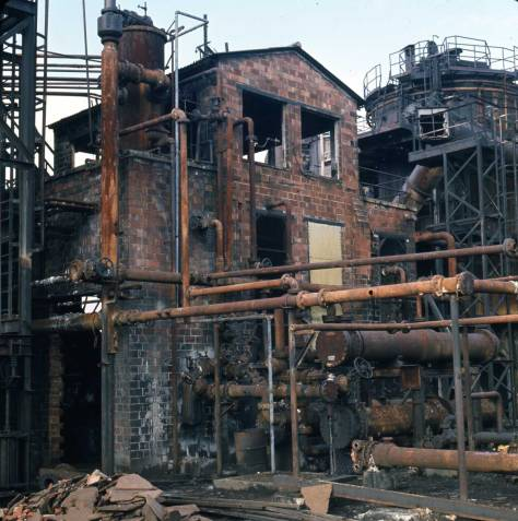 "Shaw's caption reads ""Brick Building & Pipes at Gasplant Park, Feb. 5, 1974."""
