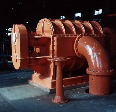 "This Shaw surprised me. It reveals that external restoration with coloring has begun on the machinery as early as early 1974.. Shaw captions this ""orange-colored machinery Gas Plat bldg, Feb. 7, 1974."""