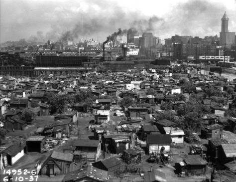 This look down into the sprawling Hooverville was recorded from the roof of the B.F.Goodrich building on East Marginal Way, which, with much else, was later removed for containers. A view of the Goodrich building appears on the right in the photo that follow, which was taken from the Hooverville dock.