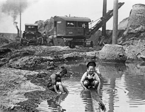 Two-boys-playing-in-Denny-Regrade-puddle-WEB