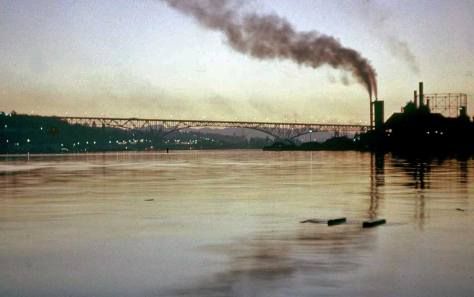Gas Works at sunset and still on fire. The pencil-scrawled caption on the original slide dates it 1956. The Aurora Bridge marks the horizon.