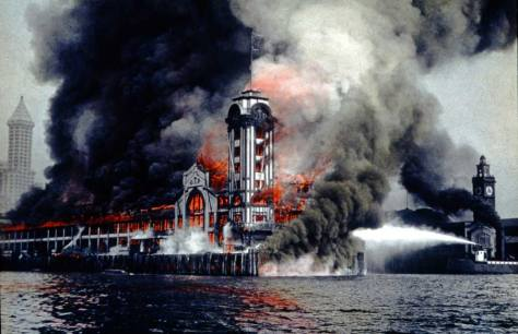 The 1914 fate of the Grand Trunk pier to burn down to its pilings. Note the Smith Tower on the right, which was dedication this year. Colman Dock on the right was saved by the fire boats that were stationed at Fire Station No. 5, directly north (to the left) of the Grand Trunk pier, which had lower insurance rates because of them.