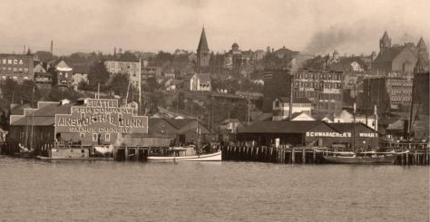 A mid-1890s look at the Pike (left) and Schwabacher (right) piers side-by-side, but not of the Baker/Arlington dock, which is off-frame to the right. (Courtesy, Ron Edge.)