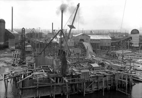"""Again, this """"other"""" look of the north end is featured with some talk in the video. Saint Alphonso's tower on 15th just punctures the far left horizon. The mill burning tower on the left and the metal warehouse right-of-center, both appear in the later photo that follows. It was recorded looking north at the bridge's north pier from below its south pier."""