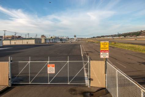 """NOW: Because of Boeing Field restrictions, Jean Sherrard's """"now"""" was taken from a prospect closer to the line-up of brewery employees and their families in the """"then,"""" than to the unidentified historical photographer."""