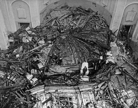 """THEN: Of the three largest Seattle roofs – the Alki Point Natatorium, a grandstand section of the U.W.'s Denny Field, and the St. James Cathedral dome - that crashed under the weight of the """"Northwest Blizzard"""" in February 1916, the last was the grandest and probably loudest. It fell """"with a crashing roar that was heard many blocks distant."""" (Courtesy Catholic Archdiocese.)"""