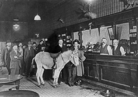 "Jean's caption ""Either the dark Demon Rum or a member of the Anti-Saloon League rides his ass to the bar."""