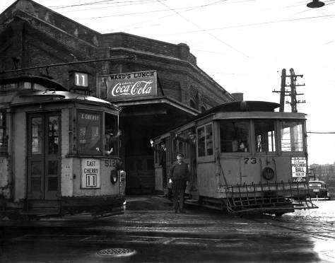 THEN: A half-century after they reached the top of First Hill, electric streets cars and cable cars prepare to leave it. (Courtesy, The Museum of History and Industry)
