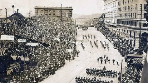 A fuller view of the stands and the Moore Theater too. The Washington Hotel, at the northeast corner of Stewart and Second Ave., is on the far right. The subject looks north, of course. (Courtesy, Bob Royer)