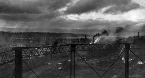 This storming look into Georgetown was photographed from the Seattle Gas Co. storage tank seen on the far left of the featured photo at the top. It is dated November 30, 1910 and the new depot can be found on the right interrupted by one of the standpipe's supports.
