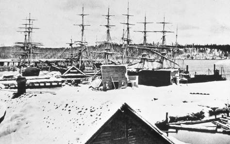 The Big Snow of 1880, with the Peterson record centered on a collapsed roof on Yesler Wharf. The King Street Coal Wharf appears beyond the tall ships. It is a West Seattle horizon.