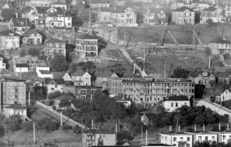 Here the Gothic twins are no more. Which one survives, we do not know (as yet). The Jensen Apartment, right of center has moved in the from the northwest corner of Mercer and Eastlake, so perhaps it was the south twin that was razed or moved far away.