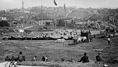The swale hosting a circus. The view looks north from near Harrison Street. Nob Hill Ave. is on the right.