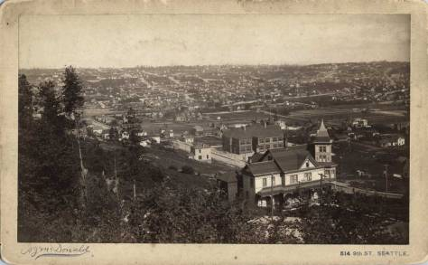 This McDonald pan was taken from within a low shouting distance of the Ward (Villiard) Street pan featured at the top. That pan just missed including a corner of the Bagley mansion at the northeast corner of Second Ave and Aloha Street, bottom-right. Mercer School is found just above and beyond it. Again the horizon is held by Capitol Hill. (Courtesy, Museum of History and Industry.)