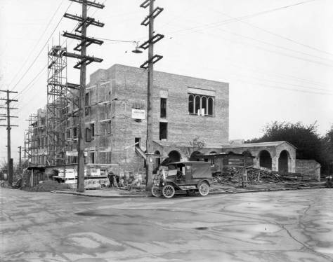 Cornish at Harvard and Roy under construction. Like the later record of the completed school, this on also looks west on Roy.
