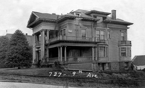 THEN: Completed in 1900, the Graham mansion on First Hill at the southwest corner of 9th Avenue and Columbia Street is getting some roof repairs in this 1937 photo looking south across Columbia Street. It was razed in the 1966 for a parking lot by its last owner and neighbor, the Catholic archdiocese.