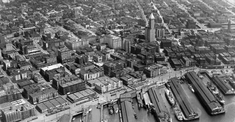 A ca. 1929 snap of the waterfront, the lower business District and the profanity hill part of First Hill. The twin towers of St. James on the upper-left will easily lead you to the Kitty-corner block now home to Skyline.