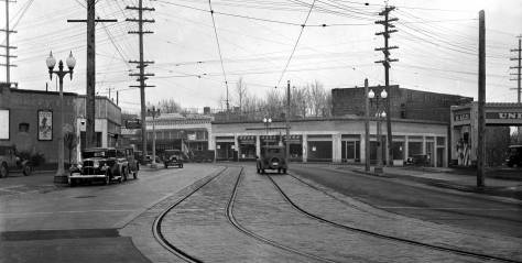 THEN: Looking south on 10th Avenue E. to the freshly re-paved intersection where Broadway splits into itself and 10th Avenue North in 1932.