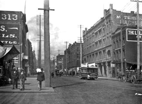 Looking north on First S. across Jackson in the late 1890s and before the 1901 construction of the Jackson Building.