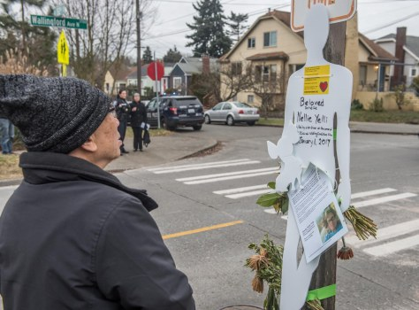 A memorial silhouette posted above the flowers honoring Nellie; one of twenty recently placed around the city by Seattle Neighborhood Greenways at sites where pedestrians have died.