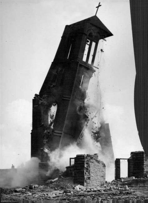 The Immaculate Heart tower topples at the corner of Sixth Avenue and Bell Street - with the help of explosives.
