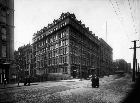 "THEN: Adding a sixth floor to its first five in 1903, the Hotel Butler entered a thirty-year run as ""the place"" for dancing in the Rose Room, dining at the Butler Grill, and celebrity-mixing in the lobby. (Courtesy Museum of History and Industry)"
