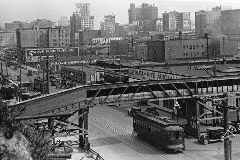 The Klean-Rite Auto Cleaners garage at the southwest corner of Fifth Avenue and Battery in 1929 with the first section of the main conveyor crossing 5th Ave. for the start of its journey to the waterfront.