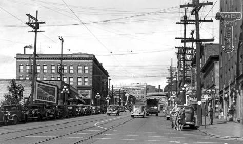 Another same day snap by the billboard rangers, Foster and Kleiser, on Pike Street, but here one block east at Terry Street. The hotels here include the William Penn, far left,