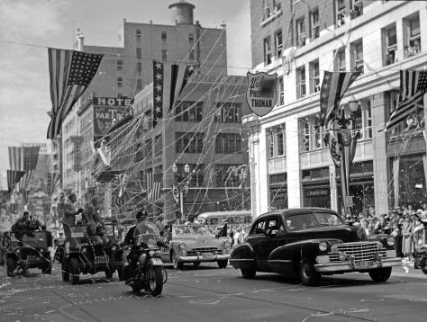 Harry Truman waving from the open convertible Cadillac at the center of the photograph. I remember the excitement attendant on Truman's visit to Spokane during the same campaign. I felt charmed by being in the same city with the President of the United States. Now, I confess to finding the same imagined coincidence a mix of dread and repulsion.