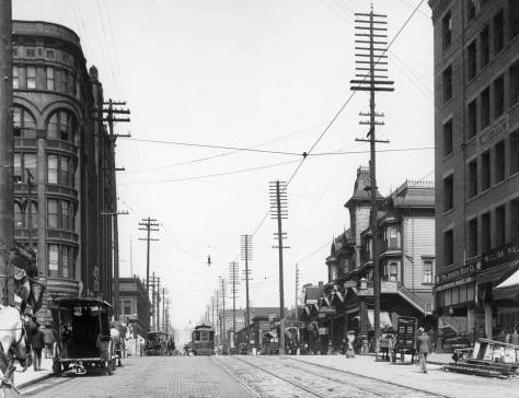 Ca. 1903, with the pioneer endurer, the Stetson Post Building on the right, and the post-1889 fire red brick landmark, the Burke Building, on the left. Of course the view looks north on Second Avenue through its intersection with Marion Street. (Courtesy, Lawton Gowey)