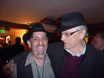Paul Nelson & George Bowering Compare Hats at the After Party (foto by Linda Crosfield)