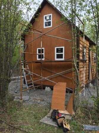 Tiny cabin exteior siding finished