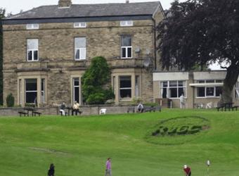 The 18th green at Reddish Vale Golf Club