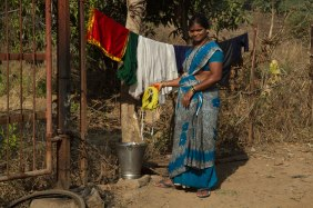 Indian Lady hanging clothes