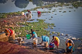 ladies in India washing clothes at river