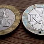 Devil Horns 'Mano Cornuto' carving in 10 French francs coin (backside 10 Francs Français)